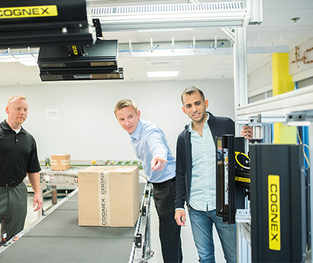 Cognex employees testing customer logistics solution