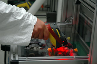 Siemens technician using cognex handheld barcode reader for manufacturing