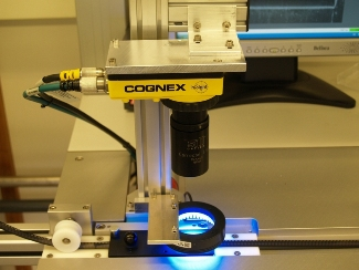 Micro Crystal Swatch Group Company cognex insight blue light defect detection