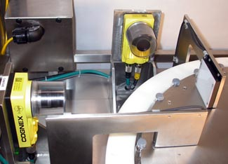 In-Sight vision systems create a new vial inspection system