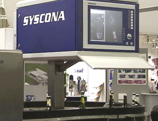Syscona inspecting labels on cylindrical objects