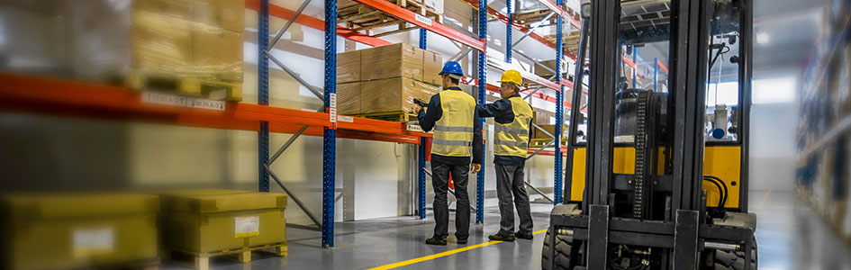 Two men use mobile barcode readers in a warehouse setting