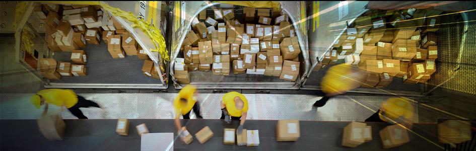 people putting boxes on conveyor belt