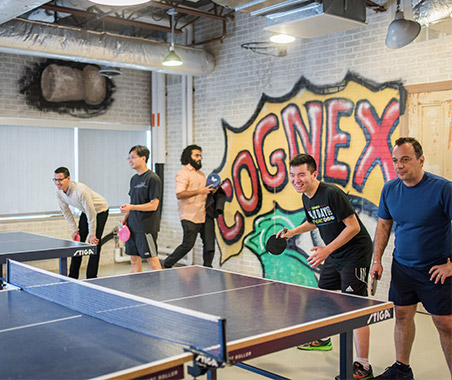 Cognex Cognoids playing ping pong in game room