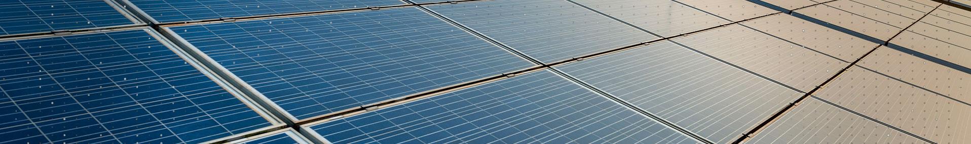 Solar panels at sunrise banner