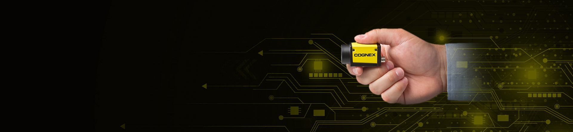 Cognex employee holding CIC Industrial Camera