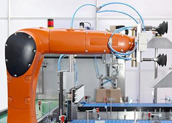 orange robotic system integrator arm