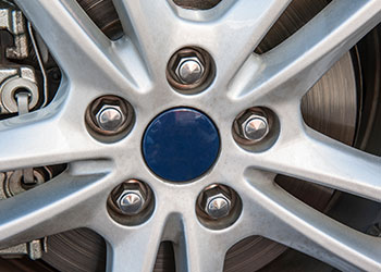 Automotive nuts fastened on rim