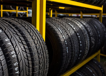 Automotive tires stacked on a rack