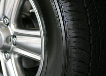up close of vehicle tire and hub cap