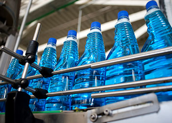 cleaning product bottles in production on a conveyor