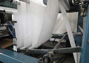 Factory automation paper on rollers for inspection