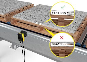 El In-Sight D900 lee códigos desafiantes de materiales de construcción en palets para mejorar la trazabilidad.