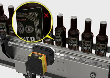 failed skewed label inspection on bottles
