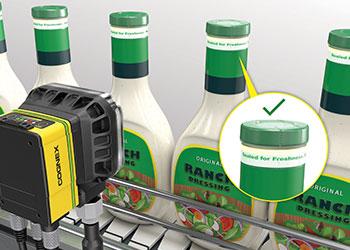 Cognex vision system inspecting tamper-proof safety seal for dressing bottle