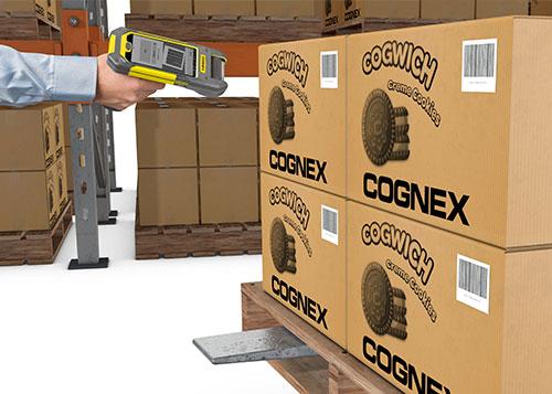 Man using mobile terminal barcode reading pallet scanning