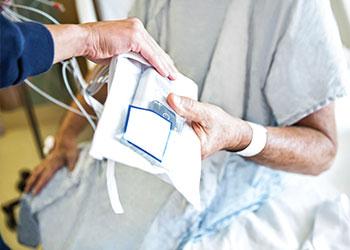 Nurse checking Patient Identification
