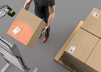 Palletizing outbound shipments after presentation scanning