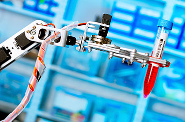 Life Science vial moved using vision guided robotics
