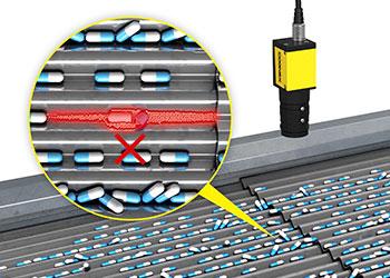 A busca do sistema de visão detecta comprimidos em um transportador