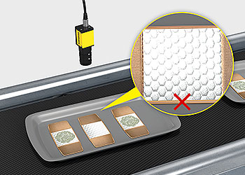 Sistema de visión inspeccionando un vendaje en busca de defectos