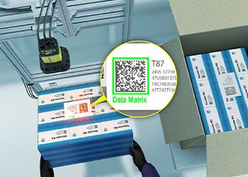 Barcode reader reading Data Matrix code on vaccine kit boxes