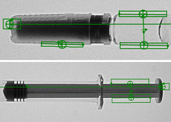 Machine vision measuring features of a syringe