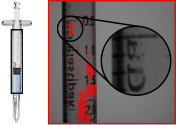 Pad printing defects detected on a syringe barrel