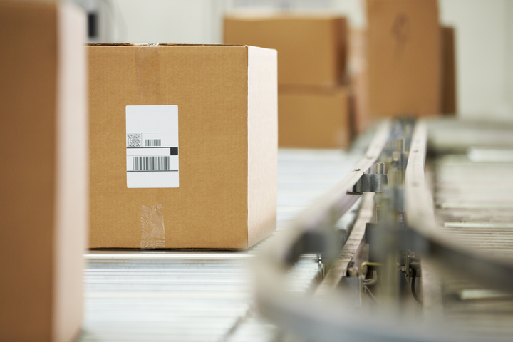 logistics package with barcode on metal conveyor