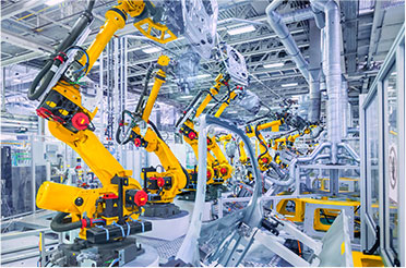 manufacturing factory with rows of vision guided automation equipment