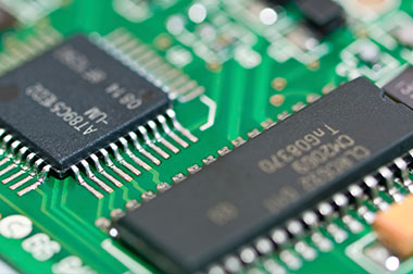up close circuit board components with codes