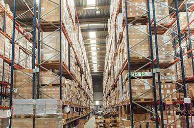 large logistics warehouse with packages stored on shelves
