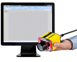 hand holding IS500 in front of easybuilder spreadsheet software on screen