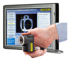 male hand holding cognex checker camera in front of computer with software preview