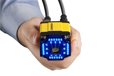 hand holding cognex dm300 with blue light attachment