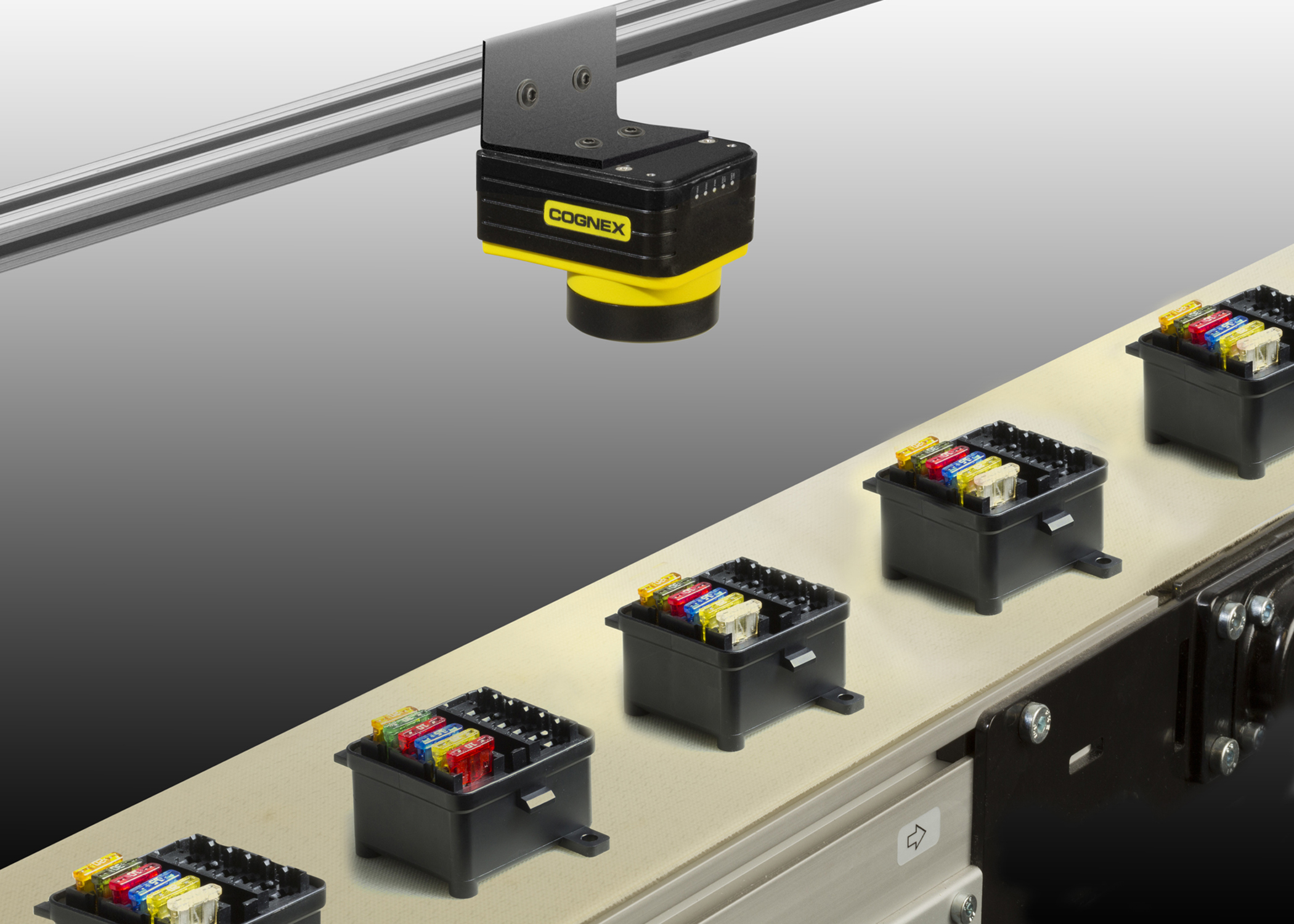 In-Sight 7010C vision system verifying colors on printer ink cartridges
