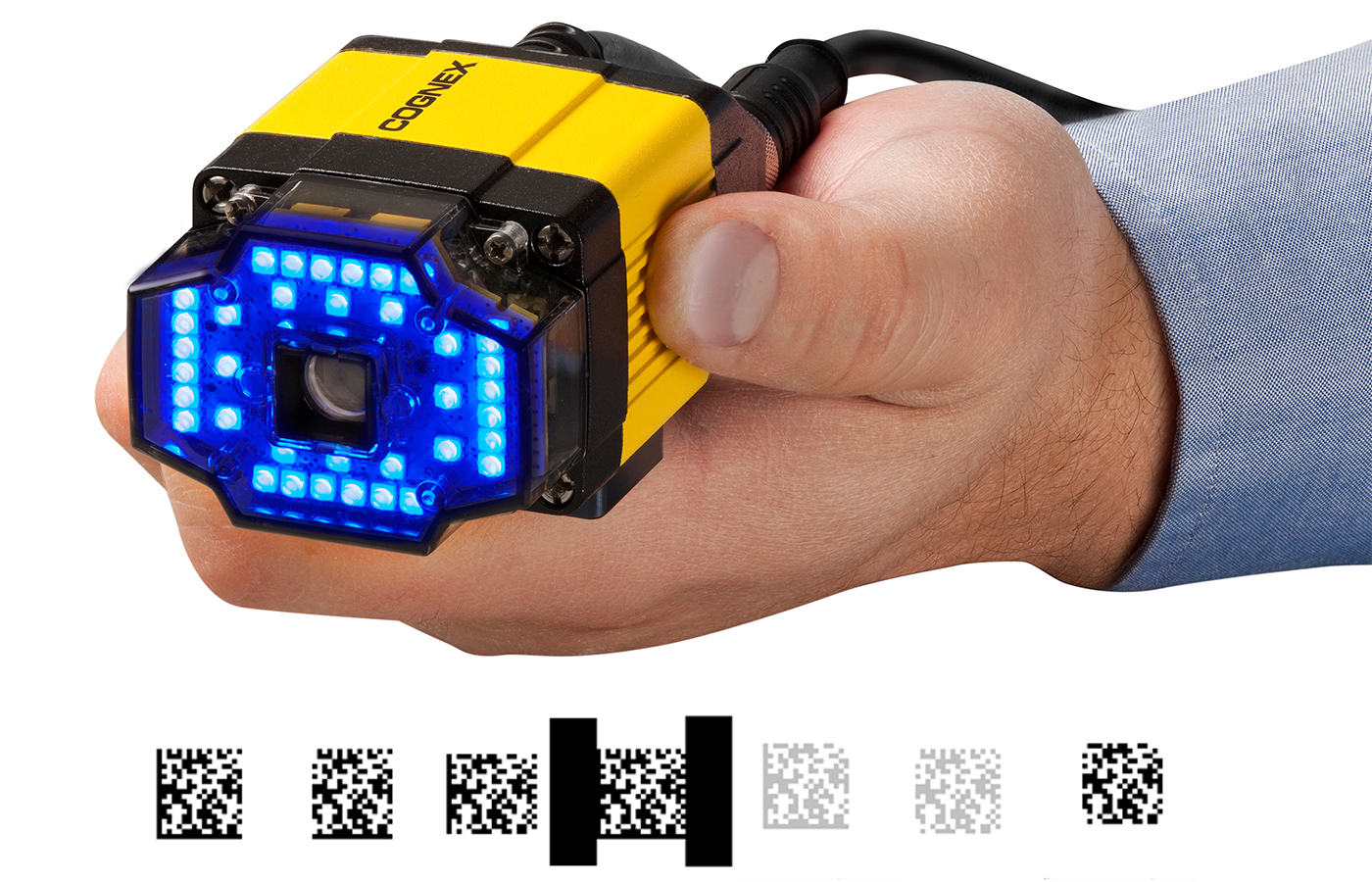 hand holding dataman 300 series blue light barcode reader with PowerGrid reading example