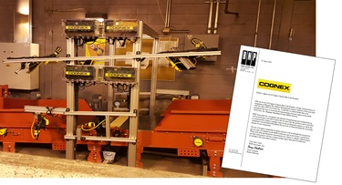 BNP Associates approval letter in front of cognex airport baggage handling system