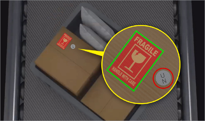 Fragile label on a box on a conveyer