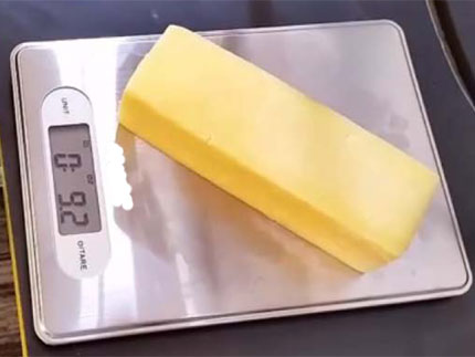 stick of butter weight on metal scale