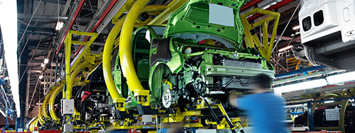 Human inspector in Automotive factory production of suspended vehicle