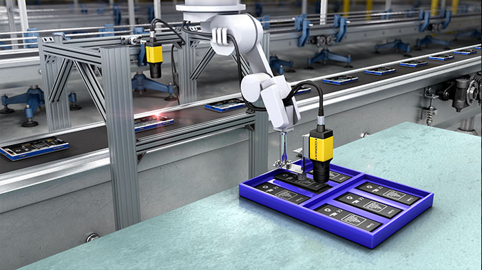 Robot picking up an electronics part using Cognex machine vision system