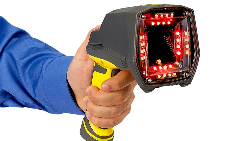 guy holding Cognex DM8072 Verifier