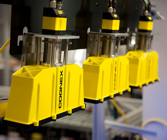 Three mounted cognex dataman readers with Xpand accessory attachments for wider field of view