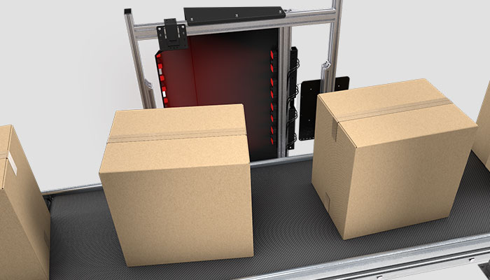 Boxes being scanned by side-mounted barcode reading system