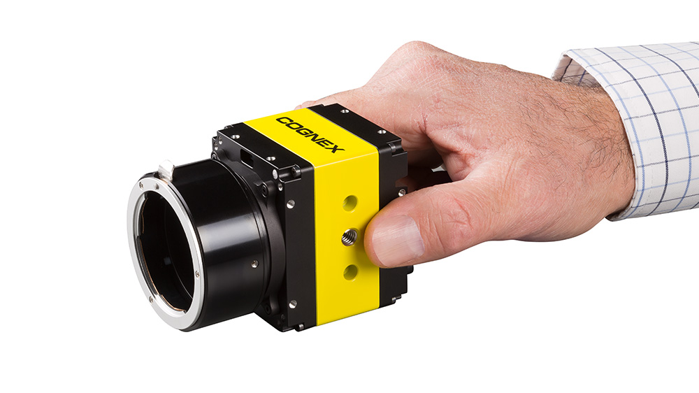 man holding an industrial cognex camera