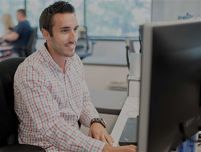 office worker watching online webinar