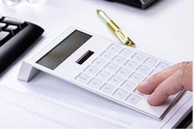 man using white calculator