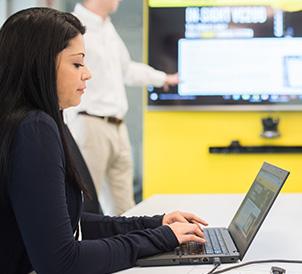 woman on laptop attending cognex seminar