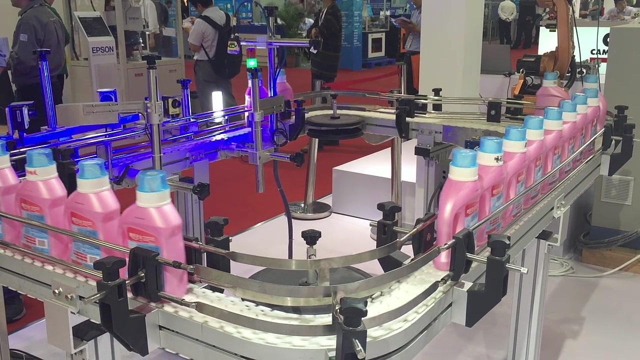 Cognex In-Sight 7000 vision system and DataMan 262 barcode reader inspect detergent bottles